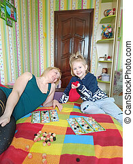 Mother and daughter playing lotto at home during quarantine due to Coronavirus