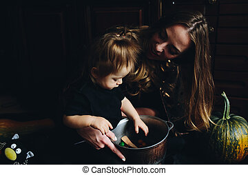 mother and daughter playing together at home