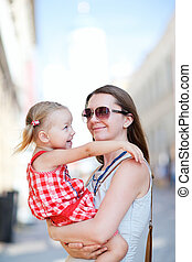 Mother and daughter portrait outdoors