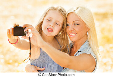 Mother and daughter pose for a self portrait