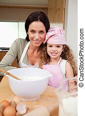 Mother and daughter preparing cake