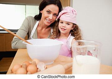 Mother and daughter preparing dough