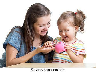 Mother and daughter put coins into piggy bank