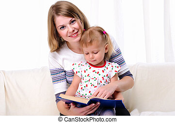 Mother and daughter reading a book