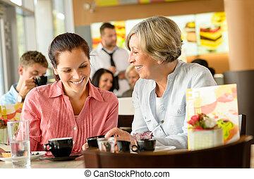 Mother and daughter relaxing in a cafe