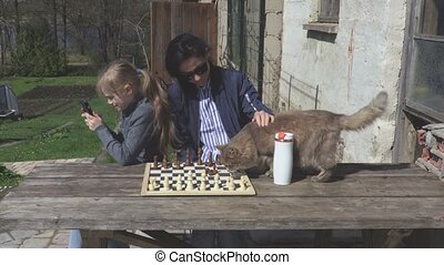 Mother and daughter relaxing near table