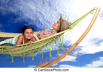 mother and daughter relaxing on the hammock
