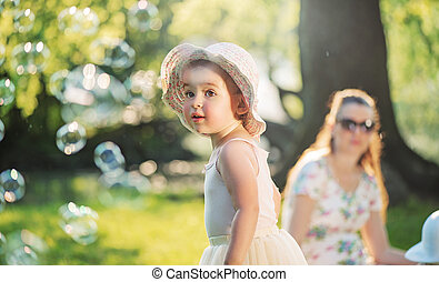 Mother and daughter resting in the park