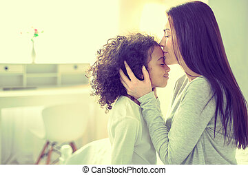 Mother and daughter sharing a tender moment of love.