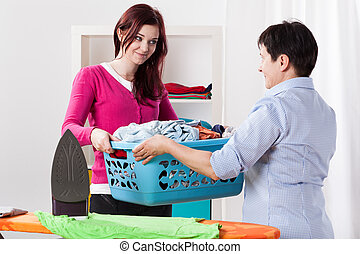 Mother and daughter during sharing house chores