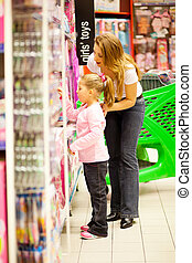mother and daughter shopping for toys