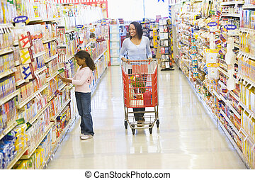 Mother and daughter shopping in supermarket