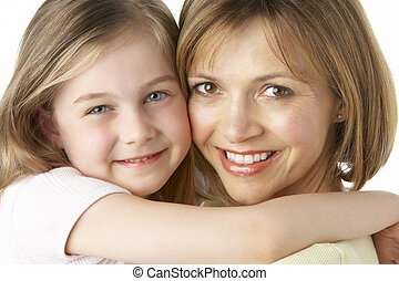 Mother And Daughter Smiling And Hugging