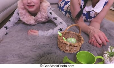 Mother and daughter sorting decorative Easter eggs