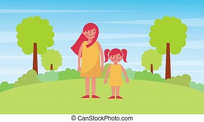 mother and daughter standing in the park