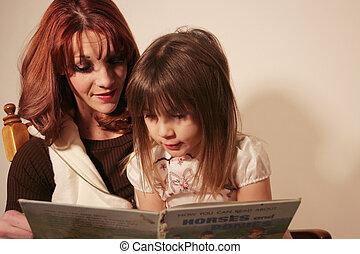 Mother and Daughter - A mother and daughter are reading a...