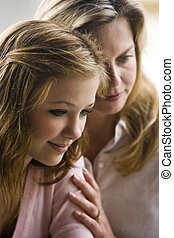 Mother and daughter - Closeup of mother with teenage...