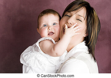 Mother and Daughter - Mother and baby daughter with...