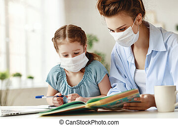 Mother and daughter studying during quarantine at home