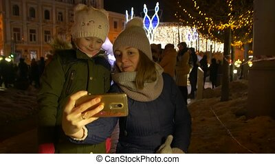 Mother And Daughter Take Christmas Selfie - Mother and...