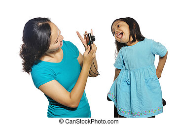 Mother And Daughter Taking Own Photograph