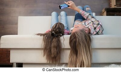 Mother and daughter taking self portrait - Joyful mother and...