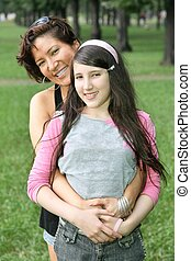 mother and daughter they stand in the parknd