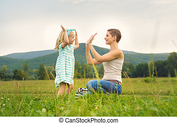 Mother and daughter time, family playing outdoors