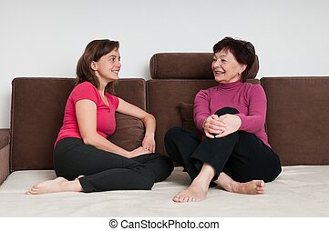 Mother and daughter together at home