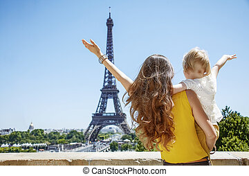 mother and daughter travellers rejoicing and looking at...
