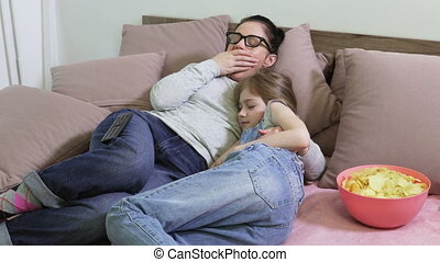 Mother and daughter turn off TV and start sleeping