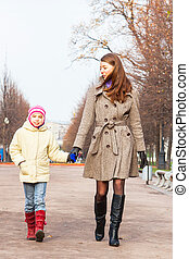 Mother and daughter walking in the