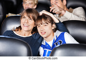Mother And Daughter Watching Film In Theater