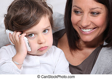 Mother and daughter with a mobile telephone