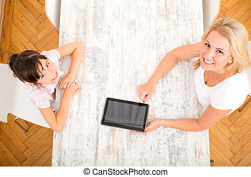 Mother and Daughter with a Tablet PC