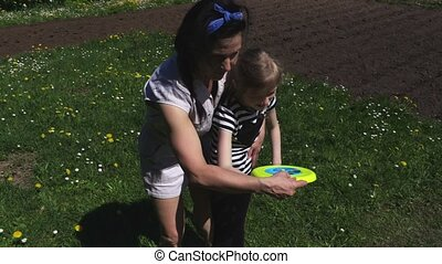 Mother and daughter with frisbee disc