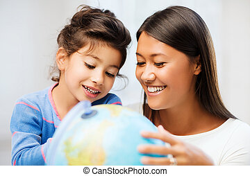 mother and daughter with globe - family, children,...