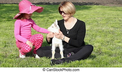 mother and daughter with goat