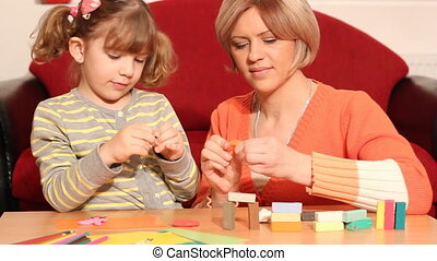 mother and daughter with plasticine