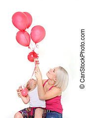 mother and daughter with red balloons over white