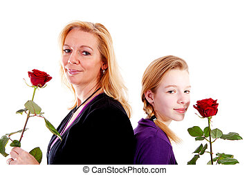 Mother and daughter with red roses