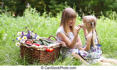Mother and daughter with vegetables