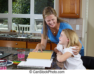 Mother and daughter working on homework - Front view of mom...
