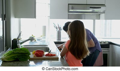 Mother and daughter working together in kitchen at home 4k