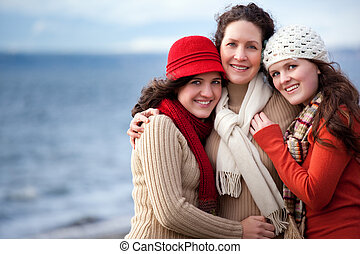 Mother and daughters - A portrait of a mother and her...