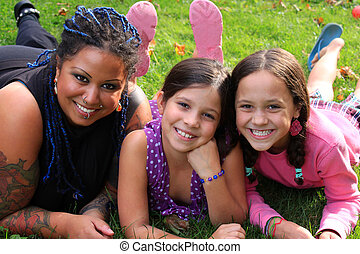 Mother and daughters - Funky pierced mother laying on the ...