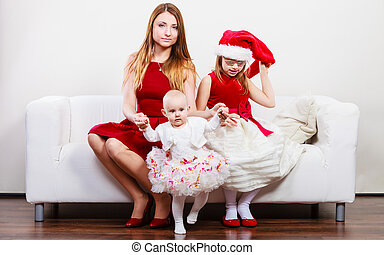 Mother and daughters in christmas outfit - Christmas family...