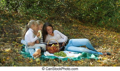 Mother and Daughters In The Park