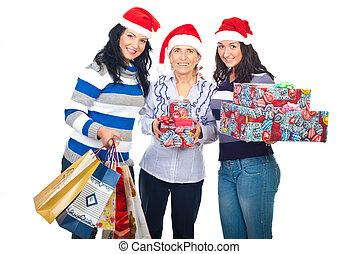 Mother and daughters with Christmas gifts