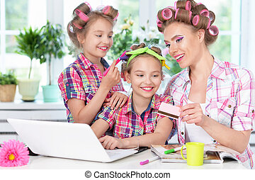Mother and daughters with laptop - portrait of happy Mother...